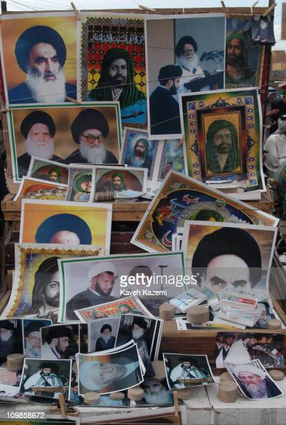 Posters of Ayatollah Sistani, Ayatollah Khomeini and other Shia religious leaders and Imams on display for sale in front of the Holy Shrine in Najaf,...
