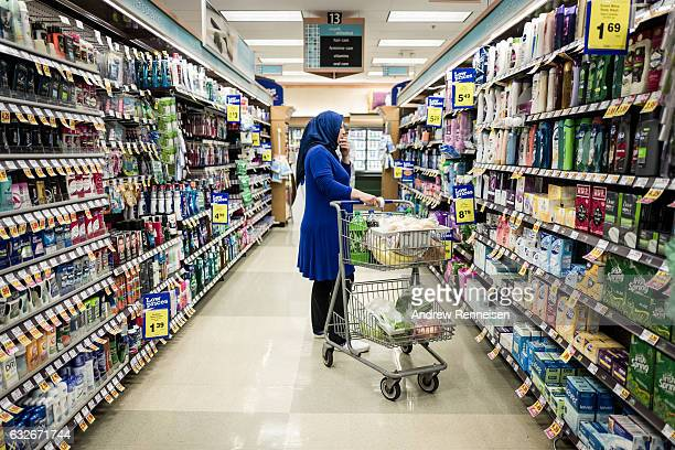 Najah Ali Mursal tries to pick out shampoo at a Kroger Supermarket without a volunteer to translate for her on July 26 2015 in Bloomfield Hills...