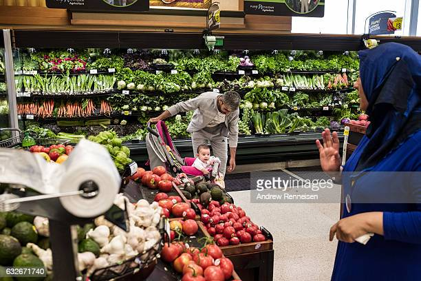 Najah and Muhammad shop at Kroger Supermarket on July 26 2015 in Bloomfield hills Michigan The community needs more volunteers to take...