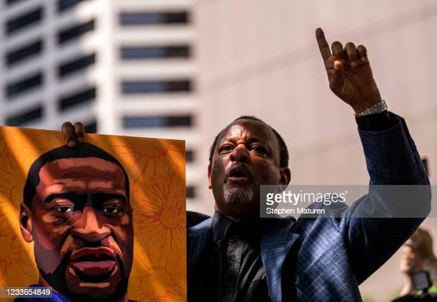 """Najee Ali chants, """"One down, three to go!"""" outside the Hennepin County Government Center after the sentencing of Derek Chauvin on June 25, 2021 in..."""