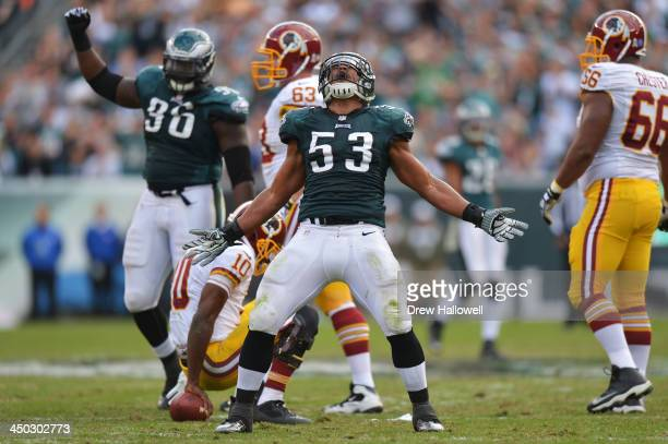 Najee Goode of the Philadelphia Eagles celebrates a sack of Robert Griffin III of the Washington Redskins at Lincoln Financial Field on November 17,...