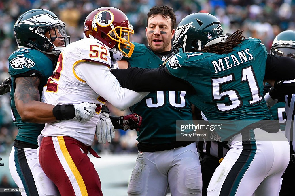 Najee Goode #52 of the Philadelphia Eagles holds back Terence Garvin #52 of the Washington Redskins s Connor Barwin #98 of the Philadelphia Eagles breaks up a scuffle with Steven Means #51 of the Philadelphia Eagles during the fourth quarter at Lincoln Financial Field on December 11, 2016 in Philadelphia, Pennsylvania. The Redskins won 27-22.