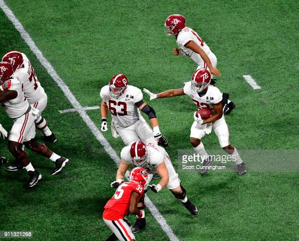 Najee Harris of the Alabama Crimson Tide carries the ball against the Georgia Bulldogs in the CFP National Championship presented by ATT at...