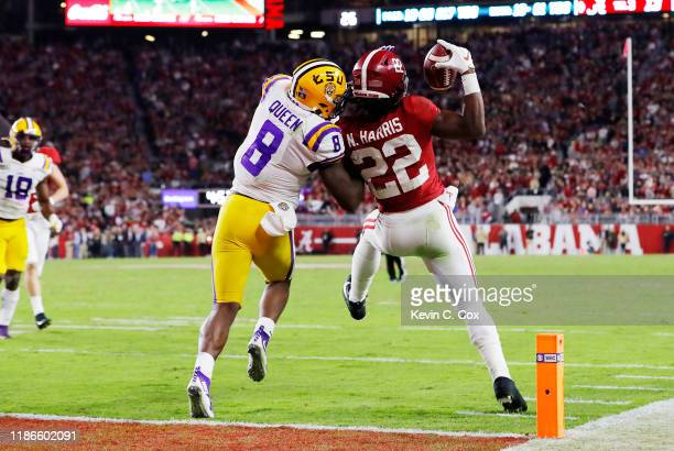 Najee Harris of the Alabama Crimson Tide catches a 15-yard touchdown pass as he is defended by Patrick Queen of the LSU Tigers during the third...