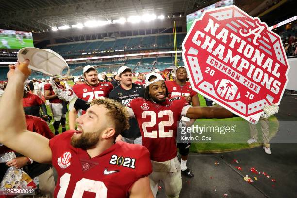 Najee Harris of the Alabama Crimson Tide celebrates following the College Football Playoff National Championship game win over the Ohio State...
