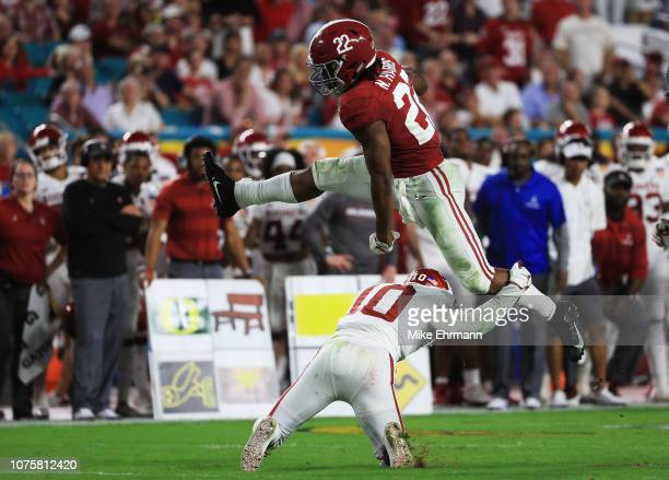 Najee Harris of the Alabama Crimson Tide hurdles over Patrick Fields of the Oklahoma Sooners in the second quarter during the College Football...