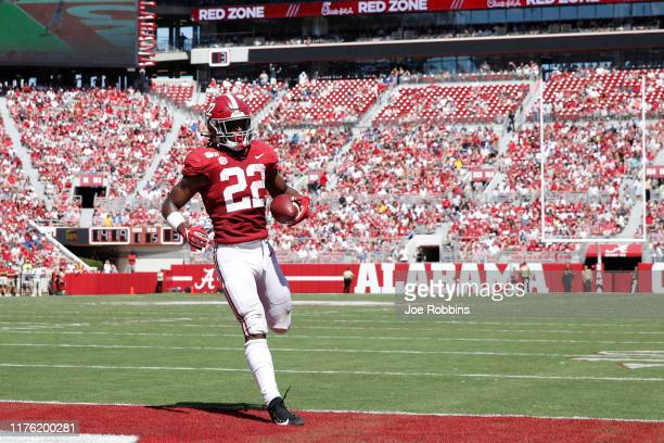 Najee Harris of the Alabama Crimson Tide runs into the end zone with a five-yard touchdown reception in the second quarter against the Southern...