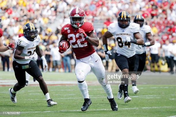 Najee Harris of the Alabama Crimson Tide runs the ball for a first down in the third quarter against the Southern Mississippi Golden Eagles at...