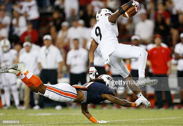 Najee Ray of the TennesseeMartin Skyhawks tackels Linden Stephens of the Cincinnati Bearcats after intercepting a pass during the fourth quarter at...