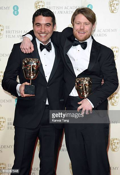 Naji Abu Nowarn and Rupert Lloyd winners of the Outstanding Debut award for 'Theeb' pose in the winners room at the EE British Academy Film Awards at...