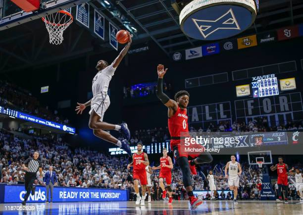 Naji Marshall of the Xavier Musketeers goes up for a dunk during the second half against the Cincinnati Bearcats at Cintas Center on December 7, 2019...