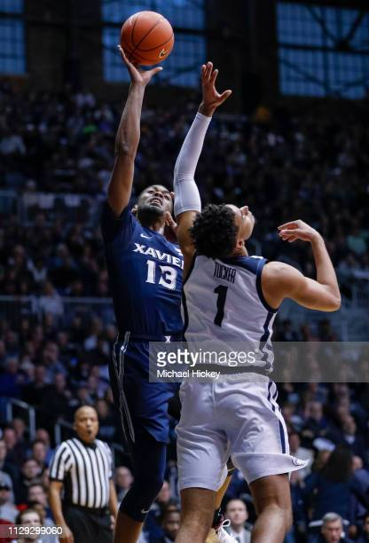 Naji Marshall of the Xavier Musketeers shoots the ball against Jordan Tucker of the Butler Bulldogs at Hinkle Fieldhouse on March 5 2019 in...