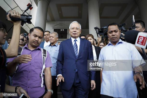 Najib Razak Malaysia's former prime minister center leaves the Kuala Lumpur Courts Complex in Kuala Lumpur Malaysia on Wednesday Dec 12...