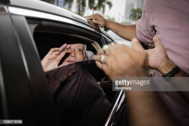 Najib Razak Malaysia's former prime minister second left leaves the Kuala Lumpur Courts Complex in Kuala Lumpur Malaysia on Thursday Sept 20 2018...