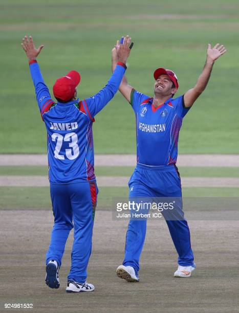 Najibullah Zadran and Javed Ahmadi of Afghanistan celebrate the wicket of Shimron Hetmyer of The West Indies during The ICC Cricket World Cup...