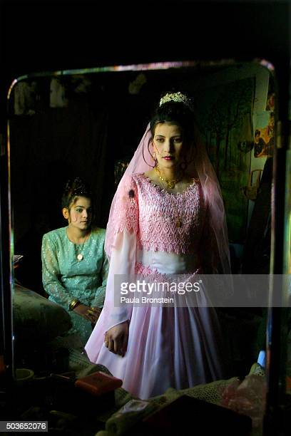 Najila Ahmadi the bride to be gets her wedding dress ready at the local beauty parlor where family help get her dressed for the big engagement party...