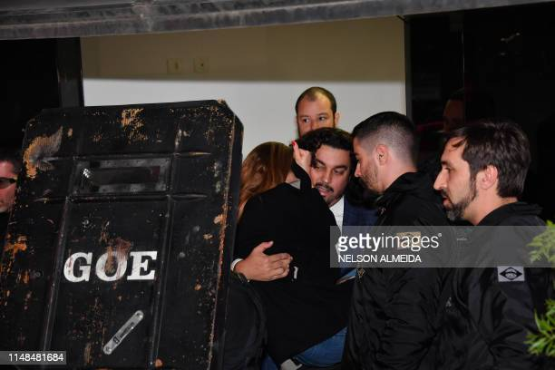 Najila Trindade Mendes de Souza is carried by her lawyer Danilo Garcia de Andrade as they leave the Women's Defence Precinct in Sao Paulo Brazil on...