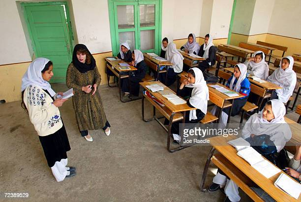 Najla listens as a student in her 4th grade class reads an excerpt from a book February 25 2002 in Kandahar Afghanistan The Zhargona Ana high school...