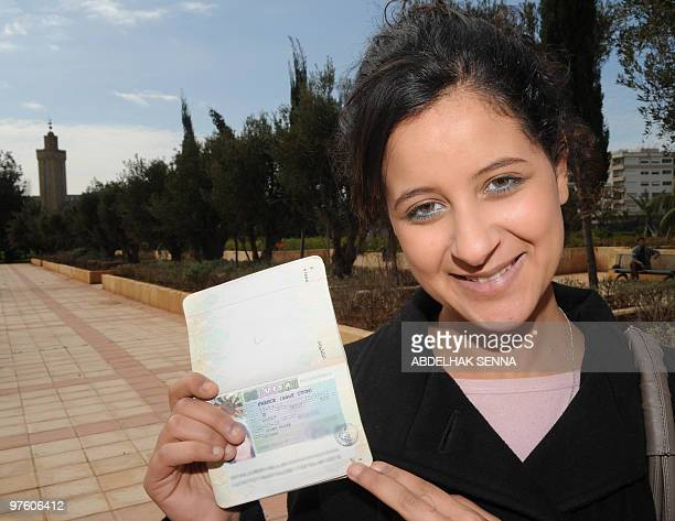 Najlae Lhimer a Moroccan high school student recently expelled from France as an illegal immigrant poses with her newly obtained French visa in Rabat...