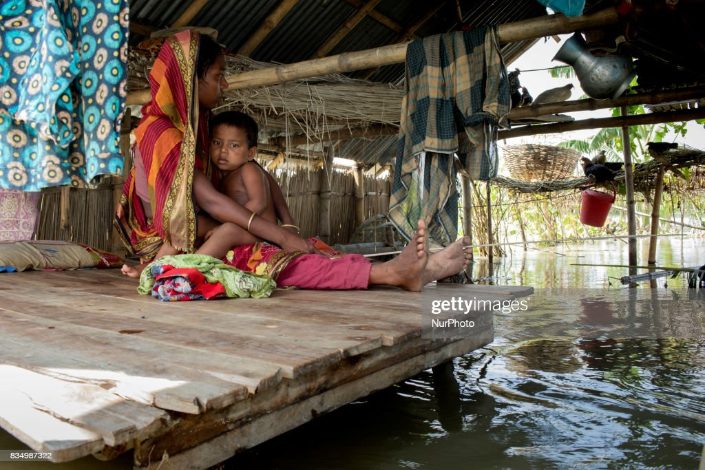 Najma with her child sits on a bed inside the flooded house at Sariakandi, Bogra, Bangladesh 17 August 2017. According to authorities, floods caused by heavy rainfall lashing Bangladesh during the past week have left at least 56 people dead. Affected people are waiting to get more relief as they are in shortage of food and drinking water in the shelter centers.