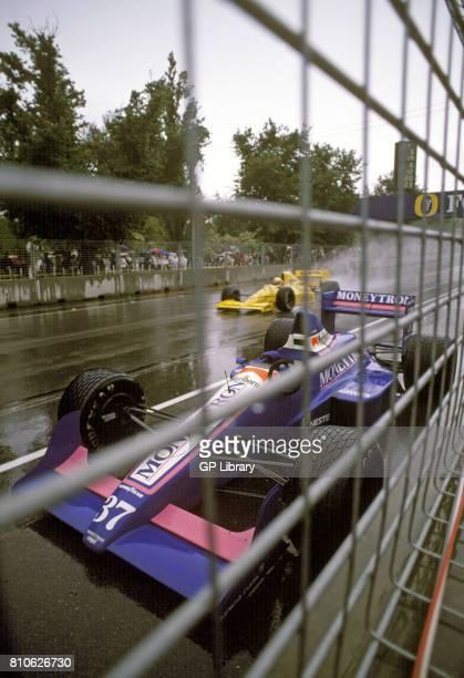 Nakajima in a Lotus 101 4th and an abandoned J-J. Lehto Onyx ORE-1 at Adelaide, Australian GP.