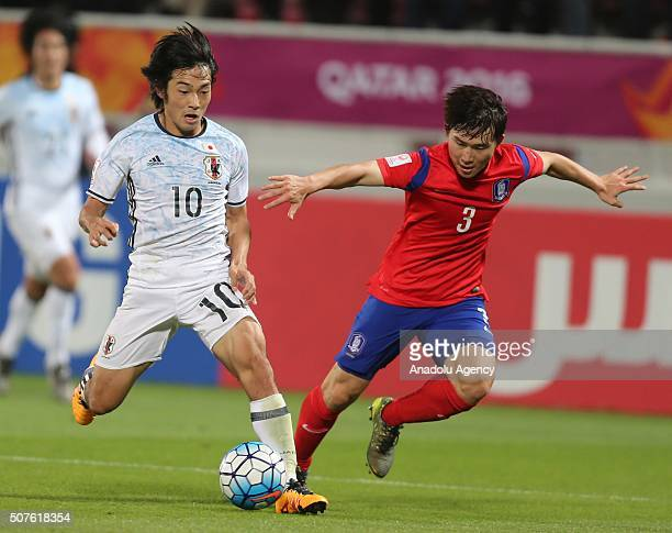 Nakajima Shoya of Japan vies with Lee Seulchan of South Korea during the AFC U23 Championship final match between South Korea and Japan at the...