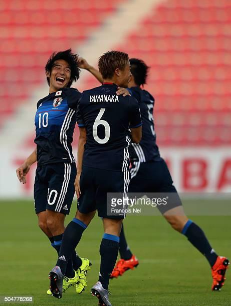 Nakajima Shoya Ryosuke Oshima and Ueda Naomici of Japan celebrates after the opening goal during the AFC U23 Championship Group B match between Japan...