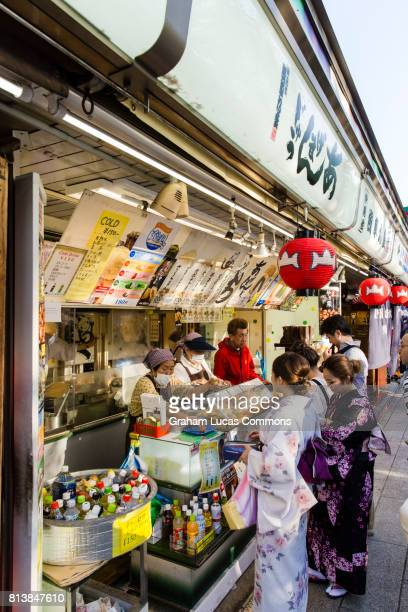 Nakamise-dori Street Leading Towards Senso-ji Temple, Asakusa, Tokyo, Lined with Tourists Shops, Food Stalls and Crafts.