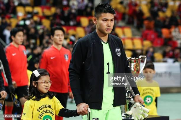 Nakamura Kosuke of Japan walks into the field during the EAFF E-1 Football Championship match between South Korea and Japan at Busan Asiad Main...