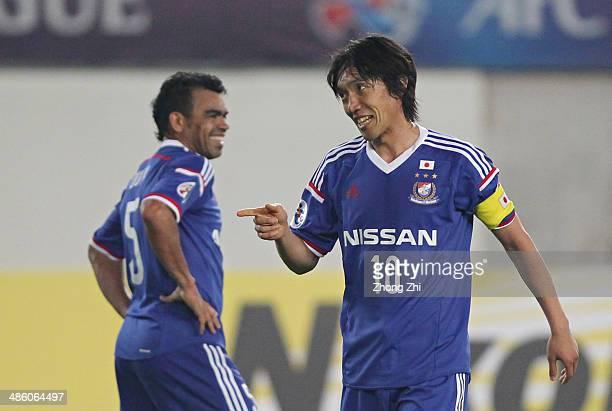 Nakamura Shunsuke and Antonio Monteiro Dutra of Yokohama F Marinos react during the AFC Asian Champions League match between Guangzhou Evergrande and...