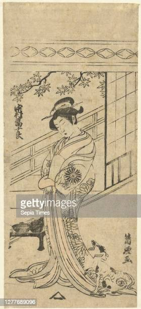 Nakamura Tomijuro in female role, The actor Nakamura Tomijiro in female role, in kimono with chrysanthemum pattern, standing with dog next to low...