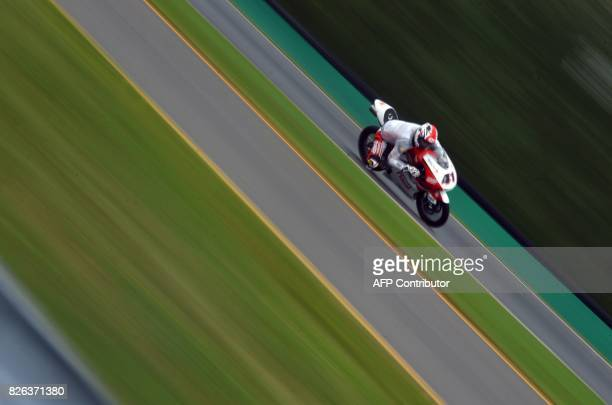 TOPSHOT Nakarin Atiratphuvapat of Thailand rides his Honda during a free practice session prior to the Moto3 Czech Grand Prix race in Brno Czech...