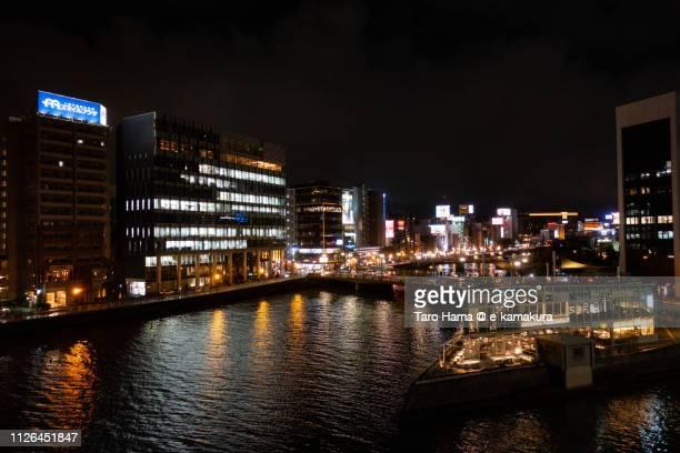 nakasu district in hakata-ku of fukuoka city in japan in the night - fukuoka prefecture stock pictures, royalty-free photos & images