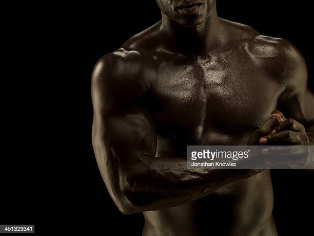 Naked athletic male,detail muscular chest and arms