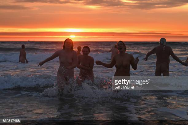 Naked bathers enter the water as they take part in the North East Skinny Dip at Druridge bay on September 25 2017 in Druridge England The popular...