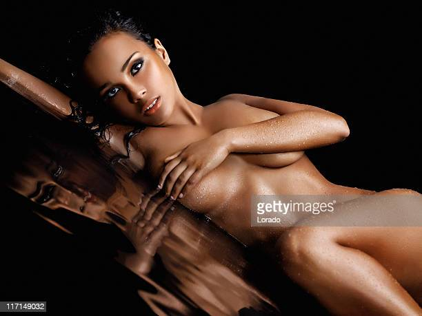 naked beautiful woman posing in water