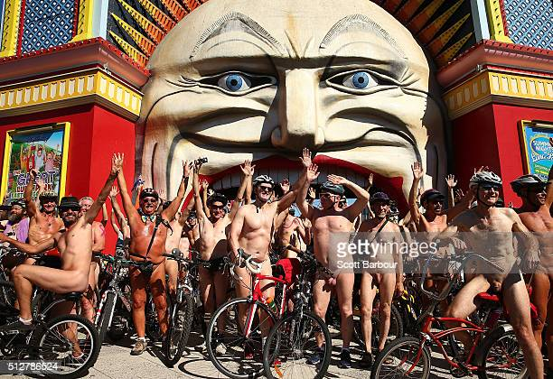 Naked bike riders pose for photographs outside of the historic amusement park Luna Park during the 2016 World Naked Bike Ride on February 28 2016 in...
