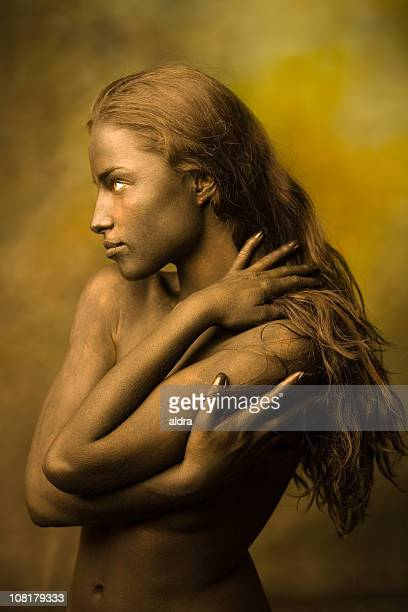 Naked Body Painted Young Woman with Long Hair Posing