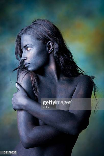 Naked Body Painted Young Woman Wrapping Arms Around Herself
