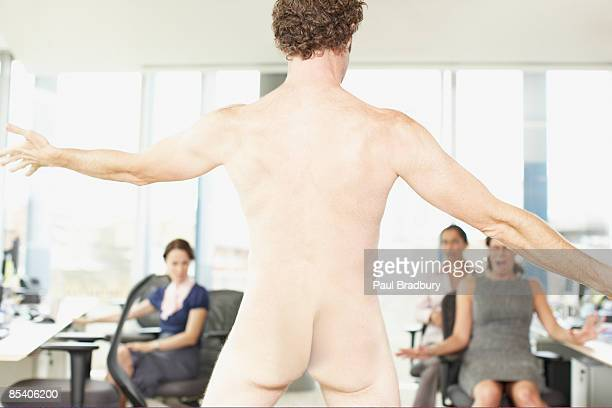 naked businessman in office - women dressed undressed stock pictures, royalty-free photos & images