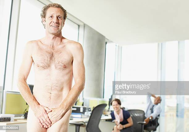naked businessman in office - female flasher stock pictures, royalty-free photos & images