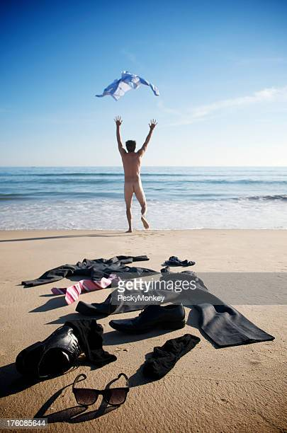 Naked Businessman Stripping Off His Suit Empty Beach