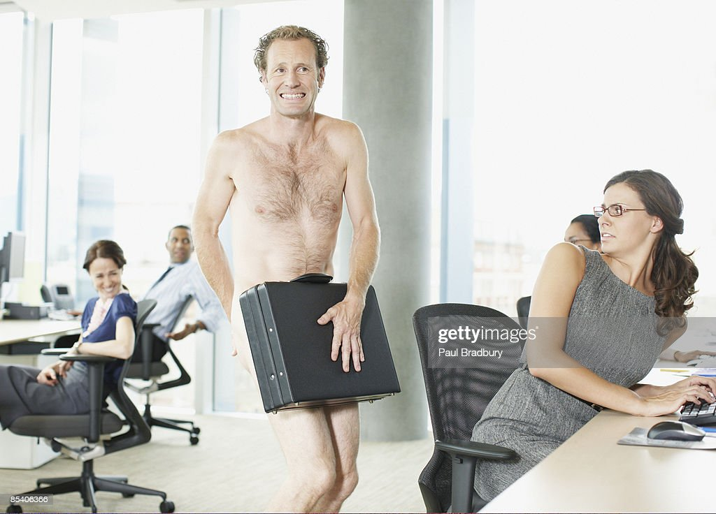 Naked businessman with briefcase in office : Stock Photo