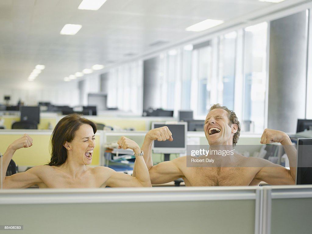 Naked businesspeople flexing muscles in office : Stock Photo