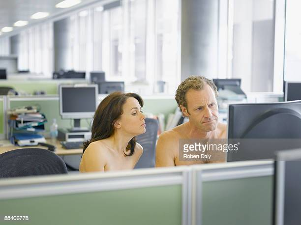 naked businesspeople working in office - naturism stock photos and pictures