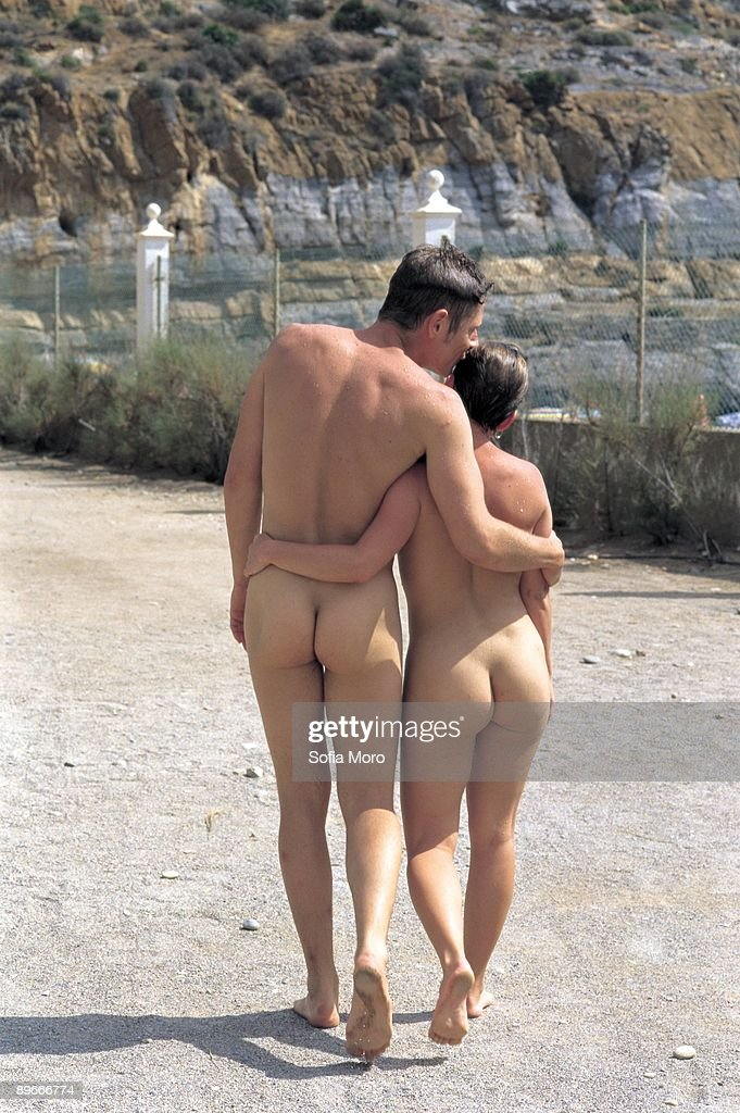 Men kissing while naked