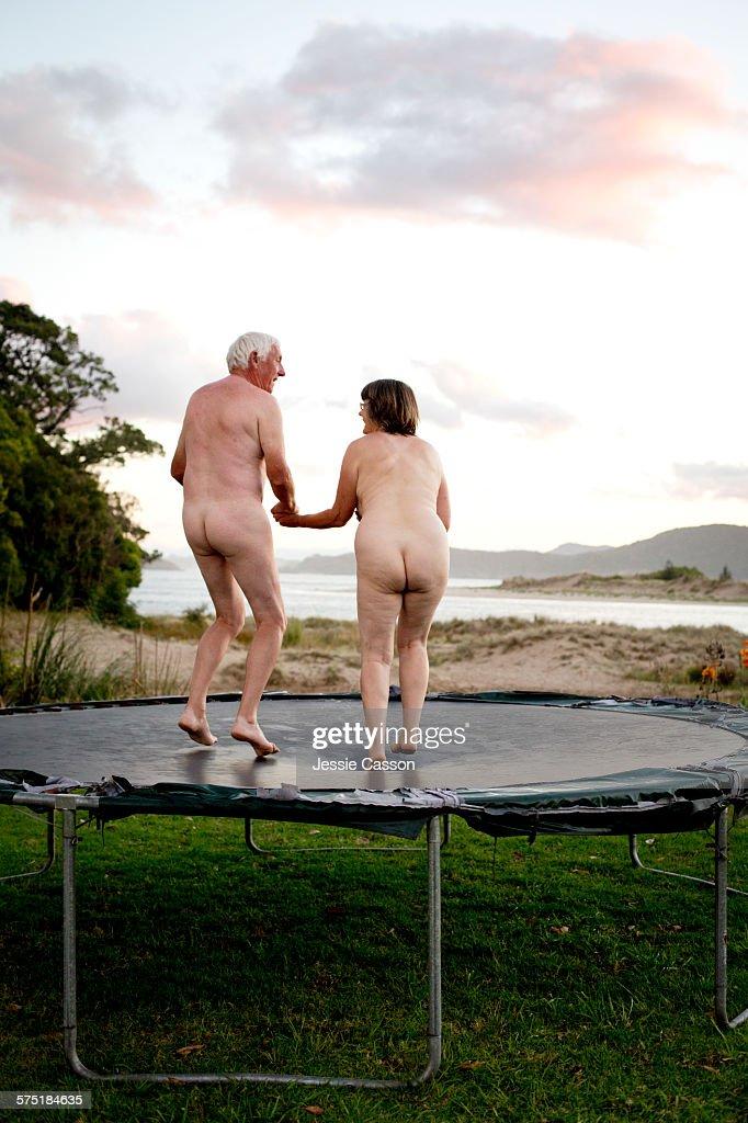 Naked couple on Trampoline : Stock Photo