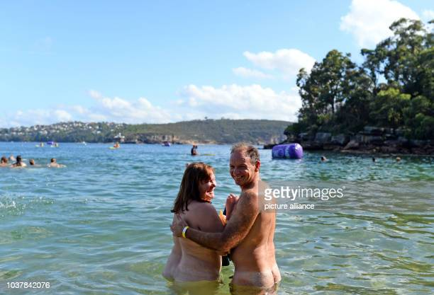 A naked couple poses in the Pacific Ocean before kickoff in Sydney Australia 28 February 2015 Around 1500 people took part in the traditional Sydney...