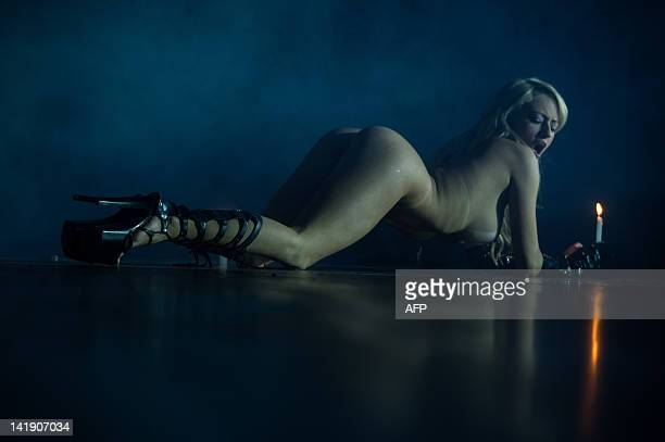 A naked dancer performs during a strip dance contest during the Erotika Fair in Sao Paulo Brazil on March 25 2012 The annual fair of products and...