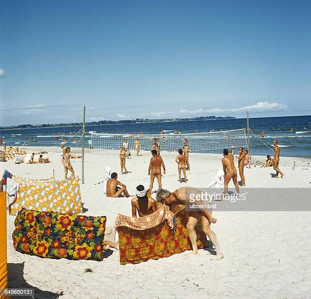 Naked East Germans enjoying their holiday on a nudist beach on the Island of Ruegen around 1980